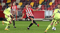 Christian Norgaard of Brentford passes the ball upfield during Brentford vs Newcastle United, Carabao Cup Football at the Brentford Community Stadium on 22nd December 2020