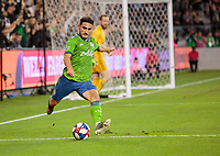 LOS ANGELES, CA - OCTOBER 29: Cristian Roldan #7 of the Seattle Sounders FC sends a ball up field during a game between Seattle Sounders FC and Los Angeles FC at Banc of California Stadium on October 29, 2019 in Los Angeles, California.