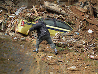 Rescue efforts in Rio de Janeiro, Brazil, in the Prazeres slum, 2 days after torrential rains. At least 107 people were killed in Rio state.