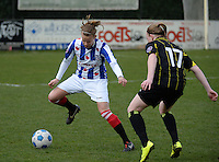 20140315 - WESTERLO , BELGIUM : Heerenveen Marieke De Boer pictured with Lierse Silke Leynen (r) during the soccer match between the women teams of SK Lierse Dames  and SC Heerenveen Vrouwen , on the 19th matchday of the BeNeleague competition Saturday 15 March 2014 in Westerlo . PHOTO DAVID CATRY