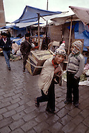 Child street vendors in Bolivia - Child labor as seen around the world between 1979 and 1980 - Photographer Jean Pierre Laffont, touched by the suffering of child workers, chronicled their plight in 12 countries over the course of one year.  Laffont was awarded The World Press Award and Madeline Ross Award among many others for his work.