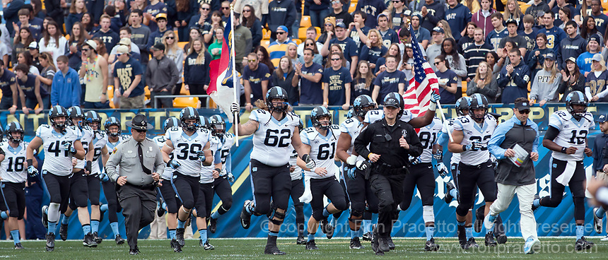 North Carolina head coach Larry Fedora and the North Carolina Tarheels take the field. The North Carolina Tar Heels defeated the Pitt Panthers 34-27 at Heinz Field, Pittsburgh Pennsylvania on November 16, 2013.