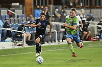 SAN JOSE, CA - OCTOBER 18: Cristian Espinoza #10 of the San Jose Earthquakes is defended by Shane O'Neill #27 of the Seattle Sounders during a game between Seattle Sounders FC and San Jose Earthquakes at Earthquakes Stadium on October 18, 2020 in San Jose, California.