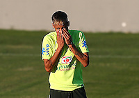 Neymar of Brazil wipes his face during training ahead of tomorrow's World Cup quarter final vs Colombia tomorrow