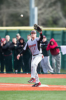 Hartford Hawks first baseman David MacKinnon (19) stretches for a throw during the game against the Virginia Cavaliers at The Ripken Experience on February 27, 2015 in Myrtle Beach, South Carolina.  The Cavaliers defeated the Hawks 5-1.  (Brian Westerholt/Four Seam Images)