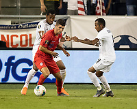 KANSAS CITY, KS - JUNE 26: Michael Murillo #23 challenges Christian Pulisic #10 while Marcos Sanchez #8 looks on during a game between Panama and USMNT at Children's Mercy Park on June 26, 2019 in Kansas City, Kansas.