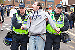 © Joel Goodman - 07973 332324 . 05/05/2012 .  Luton , UK . Police detain a man at the demonstration . Approximately 1,500 people take part in an EDL ( English Defence League ) march in Luton , understood to have been policed by over 1,000 officers . Photo credit: Joel Goodman
