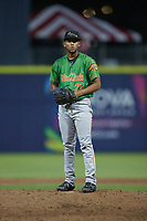 Down East Wood Ducks relief pitcher Abdiel Mendoza (22) looks to his catcher for the sign against the Kannapolis Cannon Ballers at Atrium Health Ballpark on May 5, 2021 in Kannapolis, North Carolina. (Brian Westerholt/Four Seam Images)