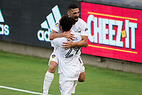 LOS ANGELES, CA - AUGUST 22: Sebastian Lletget #17  of the Los Angeles Galaxy celebrates his goal with team mate  Ethan Zubak #29 during a game between Los Angeles Galaxy and Los Angeles FC at Banc of California Stadium on August 22, 2020 in Los Angeles, California.