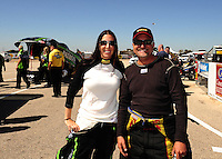 Sept. 23, 2011; Ennis, TX, USA: NHRA funny car driver Alexis DeJoria (left) with teammate Jeff Arend during qualifying for the Fall Nationals at the Texas Motorplex. Mandatory Credit: Mark J. Rebilas-