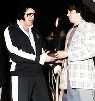 BNPS.co.uk (01202 558833)<br /> Pic: Todd Slaughter/BNPS<br /> <br /> Pictured: Todd Slaughter with Elvis before he performed his final concert 6 weeks before he died<br /> <br /> One of the world's most renowned Elvis Presley fan clubs is expected to sell for a staggering £100,000.<br /> <br /> The Official Elvis Presley Fan Club of Great Britain was established in London in 1957 and has a membership of almost 5,000 people over 60 years on.<br /> <br /> The current president, Todd Slaughter, bought it in 1967 after working as a journalist on music magazines.