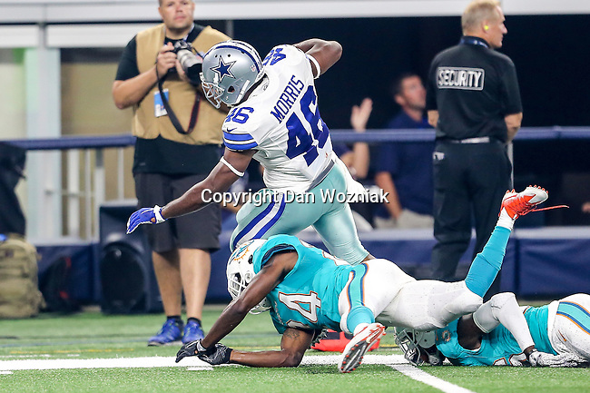 Dallas Cowboys linebacker Alfred Morris (46) and Miami Dolphins defensive back Isa Abdul-Quddus (24) in action during the pre-season game between the Miami Dolphins and the Dallas Cowboys at the AT & T stadium in Arlington, Texas.