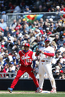 Ariel Borrero of the Cuban national team is held onto to first base by Albert Pujols of the Dominican Republic team during the World Baseball Championships at Petco Park in San Diego,California on March 18, 2006. Photo by Larry Goren/Four Seam Images
