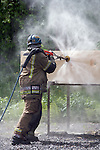 Firefighters from Oslo Brann og Rednings Etat are practicing at their training facility just outside Oslo, Norway