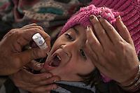 A toddler receives a polio vaccine in Karachi, Pakistan on Jan. 08, 2014
