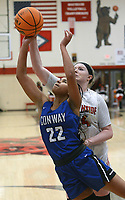 Conway's Kalayna King (22) attempts a shot as Northside's Tracey Bershers (24) blocks from behind in the third quarter on Friday, Feb. 12, 2021 in Gayle Kaundart-Grizzly Fieldhouse in Fort Smith. Conway won the game 69-56. (Special to NWA Democrat Gazette/Brian Sanderford)