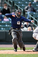 May 10, 2009:  Home plate umpire Fran Burke calls a third strike during a game at the Frontier Field in Rochester, NY.  Photo by:  Mike Janes/Four Seam Images