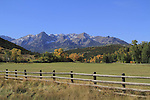 Fence, meadow and Sneffels Range with autumn colors near Telluride, Colorado.<br /> Outside Imagery Colorado fall tours by  John Kieffer.