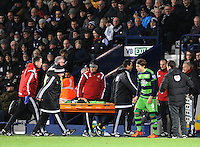 Manager Francesco Guidolin of Swansea City looks concerned for Ki Sung-Yueng of Swansea City as he is stretchered off and Alberto Paloschi of Swansea City comes on to make his debut during  the Barclays Premier League match between West Bromwich Albion and Swansea City at The Hawthorns on the 2nd of February 2016