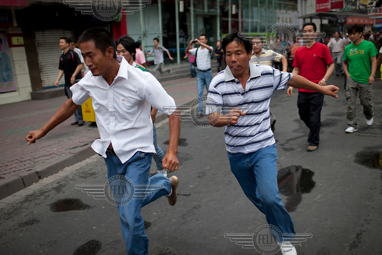 A Han Chinese mob chase down a Uighur in Urumqi. They caught up with the Uighur and beat him before the police intervened firing shots in the air and arresting the two Han attackers. The mob then attacked the police to try and stop the arrests. Ethnic violence between the Uighur and Han people had erupted in the city a few days earlier.