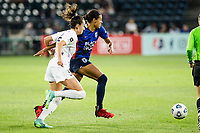 TACOMA, WA - JULY 31: Cece Kizer #5 of Racing Louisville FC and Alana Cook #4 of the OL Reign battles for the ball during a game between Racing Louisville FC and OL Reign at Cheney Stadium on July 31, 2021 in Tacoma, Washington.