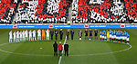 The Rangers and Airdrie players mark a minutes silence before kick-off