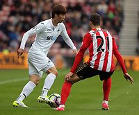 (L-R) Ki Sung-Yueng of Swansea City against Javier Manquillo of Sunderland during the Premier League match between Sunderland and Swansea City at the Stadium of Light, Sunderland, England, UK. Saturday 13 May 2017