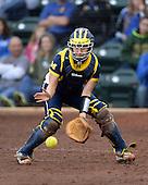 Michigan Wolverines catcher Lauren Sweet (25) fields a throw during the season opener against the Florida Gators on February 8, 2014 at the USF Softball Stadium in Tampa, Florida.  Florida defeated Michigan 9-4 in extra innings.  (Copyright Mike Janes Photography)