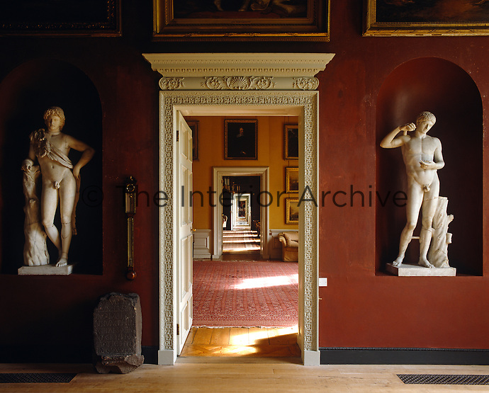 An enfilade of rooms looking from the North Gallery at Petworth House