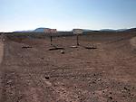Road signs in the stoney flatland and semi desert near Quarzazate in Morocco.