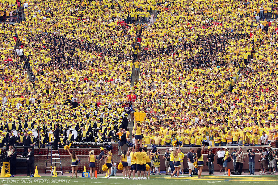 """27 September 2008: The Michigan Stadium student section form a block """"M"""" with blue-colored t-shirts within a """"Maize-Out"""", during an NCAA college football game between the Michigan Wolverines and the Wisconsin Badgers, in Ann Arbor, Michigan. Michigan upset ninth ranked Wisconsin 27-25."""