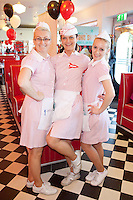 """NO REPRO FEE. 26/5/2011. NEW EDDIE ROCKET'S SHAKE SHOP. Ola Machnik, Alexandra Orban and Mihaela Orban are pictured in the new Eddie Rocket's Shake Shop. The design seeks to recall the vintage milkshake bars from 1950's America and re-imagine them for the 21st century. The new look aims to appeal to both young and old with a quirky and bold colour scheme and a concept of make-your-own milkshakes, based on the tag line """"You make it...We shake it!"""". Eddie Rocket's City Diner in the Stillorgan Shopping Centre in south Dublin has re-opened after an exciting re-vamp and the addition of a Shake Shop. Ten new jobs have been created with the Diner's re-launch bringing the total working in Eddie Rocket's Stillorgan to 30. Picture James Horan/Collins Photos"""