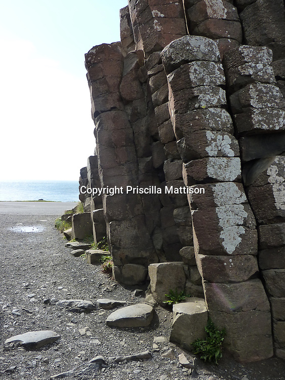 County Antrim, Northern Ireland - July 14, 2010:  Tall basalt columns lean at the Giant's Causeway.