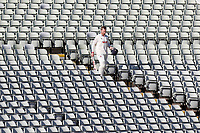 Simon Harmer of Essex walks down stairs past empty chairs during Warwickshire CCC vs Essex CCC, LV Insurance County Championship Group 1 Cricket at Edgbaston Stadium on 22nd April 2021