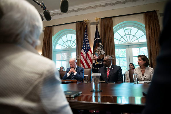 United States President Joe Biden speaks as US Secretary of Defense Lloyd J. Austin III, and US Secretary of Commerce Gina Raimondo, listen during a cabinet meeting at the White House in Washington, D.C., U.S., on Tuesday, July 20, 2021. Biden administration officials say they're starting to see signs of relief for the global semiconductor supply shortage, including commitments from manufacturers to make more automotive-grade chips for car companies. <br /> Credit: Al Drago / Pool via CNP /MediaPunch