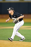 Wake Forest Demon Deacons second baseman Jimmy Redovian (23) on defense against the North Carolina Tar Heels at Wake Forest Baseball Park on March 9, 2013 in Winston-Salem, North Carolina.  The Tar Heels defeated the Demon Deacons 20-6.  (Brian Westerholt/Four Seam Images)
