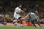 Latiume Fosita takes on James Hook.<br /> Dove Men Series 2013<br /> Wales v Tonga<br /> Millennium Stadium - Cardiff<br /> 22.11.13<br /> ©Steve Pope-SPORTINGWALES