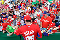 Philadelphia Phillies second baseman Chase Utley #26 signs autographs before a Spring Training game against the Boston Red Sox at Bright House Field on March 24, 2013 in Clearwater, Florida.  Boston defeated Philadelphia 7-6.  (Mike Janes/Four Seam Images)