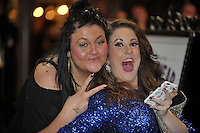 Pictured: Two women celebrate in the early hours of New Year's Day. Sunday 01 January 2017<br />Re: Revellers out celebrating the New Year in the pub and club on Wind Street Swansea