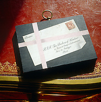 A small trompe l'oeil painting depicting an envelope addressed to the Duchess of Windsor with a portrait of the Duke incorporated into the stamp