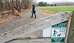 WOODBURY, CT-011521JS04- Jayne McCarthy of New Preston, walks her dog. Lola, Friday at Three Rivers Park in Woodbury. Town leaders have concerns over growing number of dogs off leash at town parks. <br /> Jim Shannon Republican-American