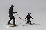 Father teaching son to ski at Loveland Ski Area, Colorado, .  John leads private ski trips to Front Range and Summit County Ski Areas in Colorado.