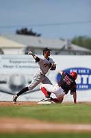 Tri-City ValleyCats shortstop Miguelangel Sierra (13) throws to first base to try to complete a double play as Micah Brown (55) slides in during a game against the Batavia Muckdogs on July 16, 2017 at Dwyer Stadium in Batavia, New York.  Tri-City defeated Batavia 13-8.  (Mike Janes/Four Seam Images)