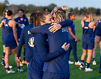 ORLANDO, FL - JANUARY 21: Kelley O'Hara #5 and Ashlyn Harris #18 of the USWNT hug after a training session at the practice fields on January 21, 2021 in Orlando, Florida.