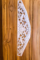Bali, Indonesia.  Template Serves as a Guide for Carving Decoration into Door Frame in a Woodcarver's Shop.
