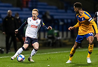 Bolton Wanderers' Ali Crawford (left) crosses under pressure from Mansfield Town's James Perch<br /> <br /> Photographer Andrew Kearns/CameraSport<br /> <br /> The EFL Sky Bet League Two - Bolton Wanderers v Mansfield Town - Tuesday 3rd November 2020 - University of Bolton Stadium - Bolton<br /> <br /> World Copyright © 2020 CameraSport. All rights reserved. 43 Linden Ave. Countesthorpe. Leicester. England. LE8 5PG - Tel: +44 (0) 116 277 4147 - admin@camerasport.com - www.camerasport.com