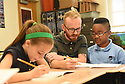 Third graders work with the teacher at the International School of Louisiana in New Orleans, Friday, Aug. 28, 2015.