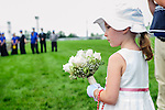 Five yerar-old Ashley  prepares to present flowers to Lieutenant Governor , David Onley,  at the 155th Queen's Plate at Woodbine Race Course in Toronto, Canada on July 06, 2014.