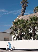 An elderly lady walking down a street in Quiet street scene in Swakopmund, Namibia