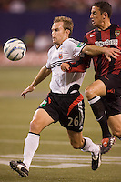 DC United's Bryan Namoff holds off Chris Leitch of the MetroStars during first half action between the MetroStars and D. C. United at Giant's Stadium, East Rutherford, NJ, on October 1, 2005.